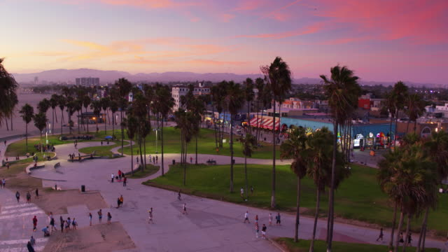 ascending drone shot of venice beach at dusk - venice beach stock videos & royalty-free footage