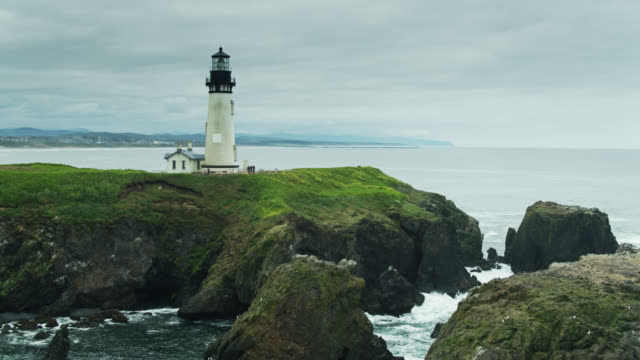 ascending drone shot of yaquina head lighthouse - oregon coast stock videos & royalty-free footage