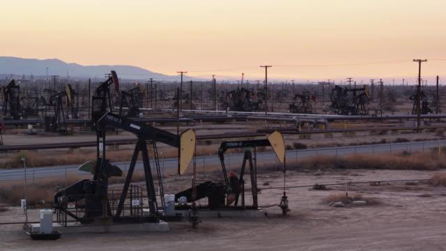 Ascending Drone Shot Past Pump Jacks in South Belridge Oil Field in Kern County, California