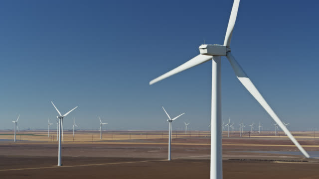 ascending drone shot past turbine in texas panhandle wind farm - propeller stock videos & royalty-free footage