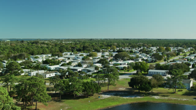 ascending drone shot revealing manufactured home community in florida - florida us state stock videos & royalty-free footage