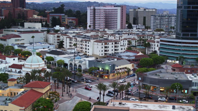 ascending drone shot with downwards tilt of westwood village, los angeles - westwood neighborhood los angeles stock videos & royalty-free footage