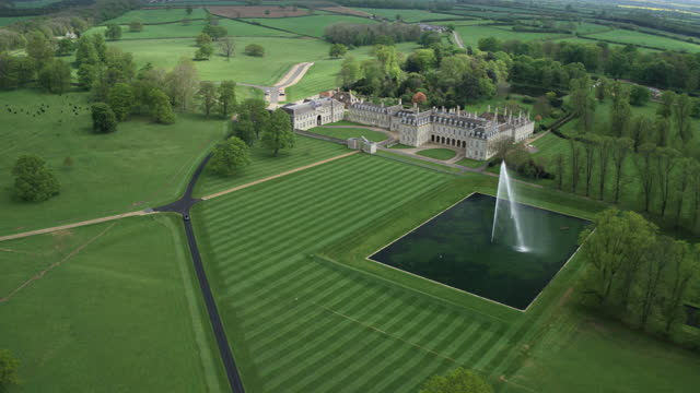 ascending shot of boughton house with the grand etang in the foreground - pasture stock videos & royalty-free footage