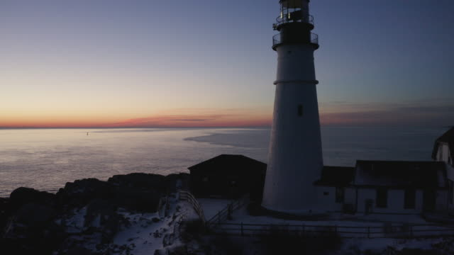 ascending shot of the portland head light at sunset - north atlantic ocean stock videos & royalty-free footage