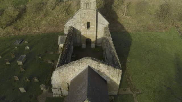 ascending shot of the ruined st martins church of wharram percy - ornate stock videos & royalty-free footage