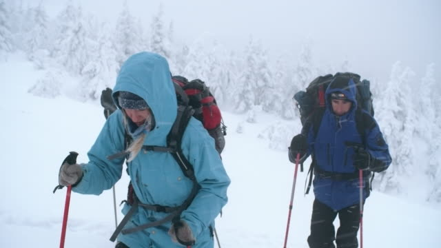 ascending the mountain in snow storm - mitten stock videos & royalty-free footage