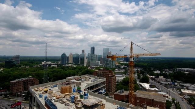 ascent against construction revealing buckhead skyline - tilt up stock videos & royalty-free footage