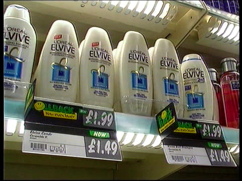 Asda price war targets chemists ITN Label by razors 'Mach 3 razor Now £299 Boots Price £499' LA CMS L'Oreal Elvive shampoo bottles on display CS...