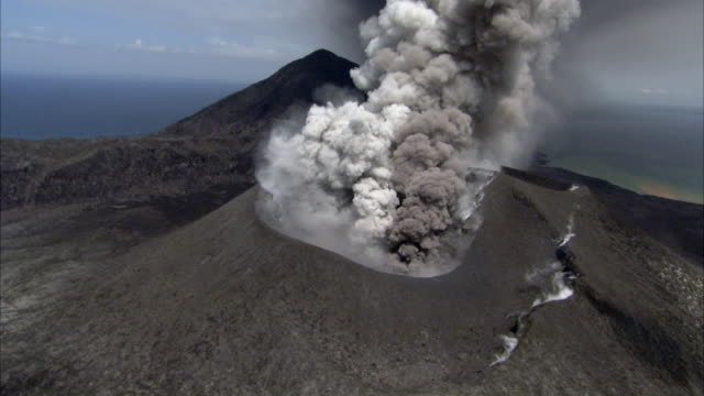 ash billows from erupting volcano, new britain, png - tectonic stock videos & royalty-free footage