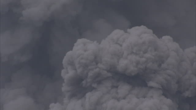 Ash billows from erupting volcano, New Britain, PNG