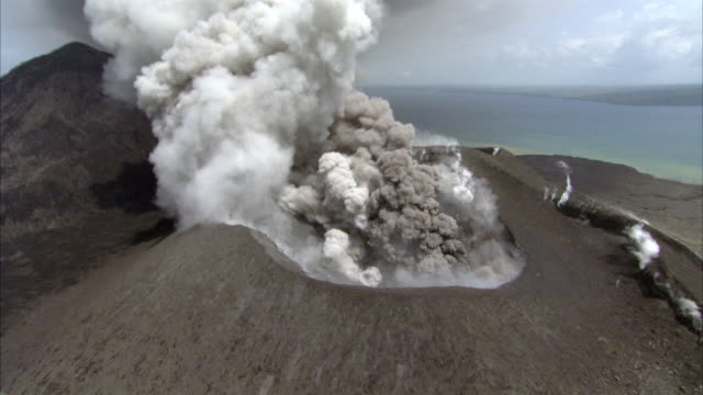 ash billows from erupting volcano, new britain, png - erupting stock videos and b-roll footage