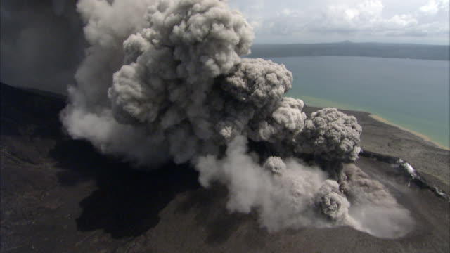 ash billows from erupting volcano, new britain, png - erupting stock videos & royalty-free footage