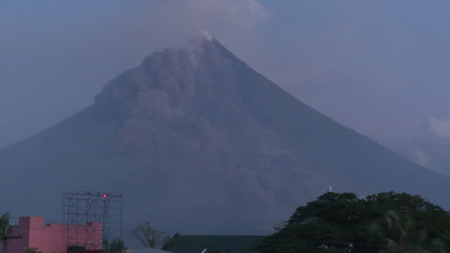 Ash cloud from pyroclastic flow drifts past side of large volcano: Mt Mayon, Philippines, December 2009