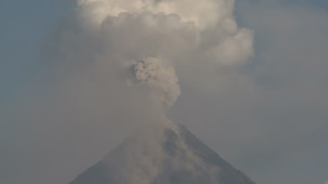 Ash erupts from the crater of Mayon volcano, Philippines, December 2009