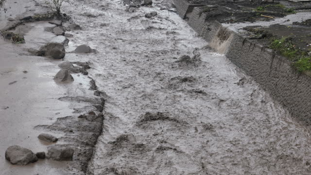 ash mud flooding from agung volcano in bali - destruction stock videos and b-roll footage