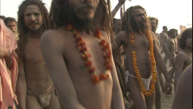 Ash-covered, garlanded Sadhus march towards Ganges, Allahabad, Uttar Pradesh, India