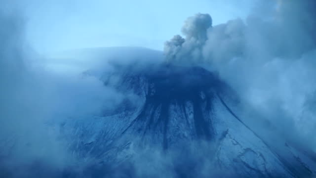 ashes rising from volcano crater - eruption stock-videos und b-roll-filmmaterial