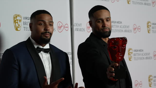 ashley and jordan banjo, diversity, pose with their tv bafta 2021 for must see moment award, for their black lives matter inspired performance on... - diversity stock videos & royalty-free footage