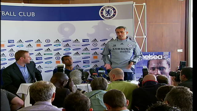 ashley cole signs to chelsea; int chelsea manager jose mourinho press conference pull out - i cannot wish luck for them , when i want all the luck... - all shirts stock-videos und b-roll-filmmaterial