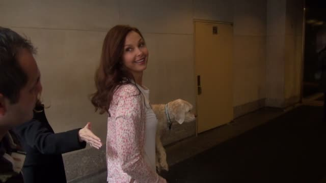 Ashley Judd carrying her dog arrives at the TODAY show in Rockefeller Plaza poses for photos with fans in Celebrity Sightings in New York