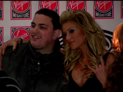 Ashley Massaro and fan at the WWE Diva Ashley Massaro Autographs Copies of Her April Playboy at Virgin Megastore Times Square in New York New York on...