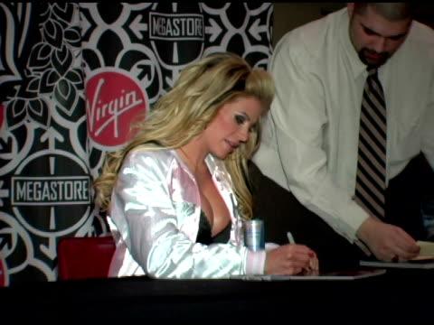 ashley massaro at the wwe diva ashley massaro autographs copies of her april playboy at virgin megastore times square in new york, new york on march... - virgin megastore点の映像素材/bロール