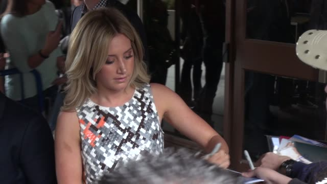ashley tisdale signs for and poses with fans outside of the theater at madison square garden for the tnttbs upfront in celebrity sightings in new york - ashley tisdale stock videos and b-roll footage