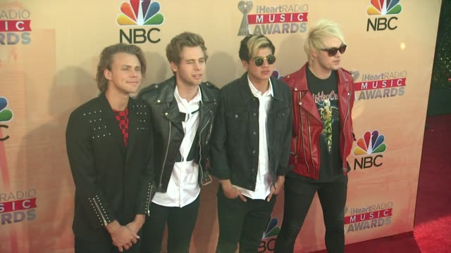 ashton irwin, calum hood, luke hemmings, and michael clifford of 5 seconds of summer at the 2015 iheartradio music awards - red carpet arrivals at... - shrine auditorium stock videos & royalty-free footage