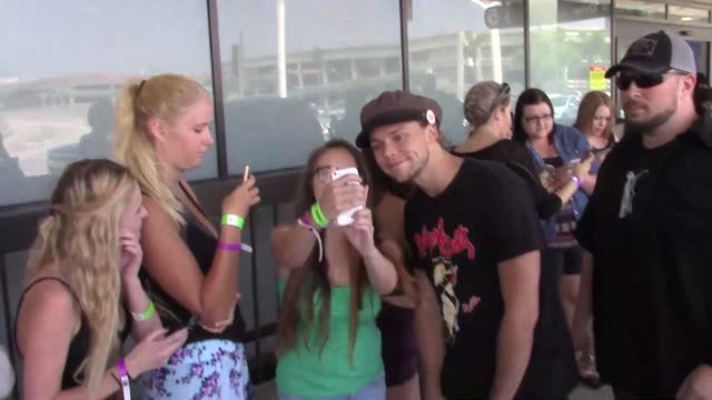 Ashton Irwin Calum Hood Luke Hemmings Michael Clifford from 5 Seconds Of Summer greeting fans at LAX Airport on August 18 2015 in Los Angeles...