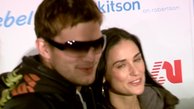 Ashton Kutcher and Demi Moore at the Rebel Yell Spring Launch arrivals at Kitson in Los Angeles California on February 19 2006