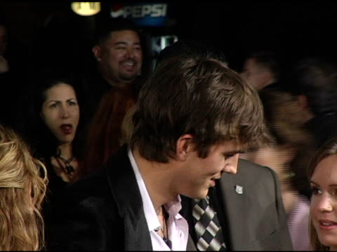 ashton kutcher at the 'guess who' premiere at grauman's chinese theatre in hollywood california on march 13 2005 - ashton kutcher stock-videos und b-roll-filmmaterial