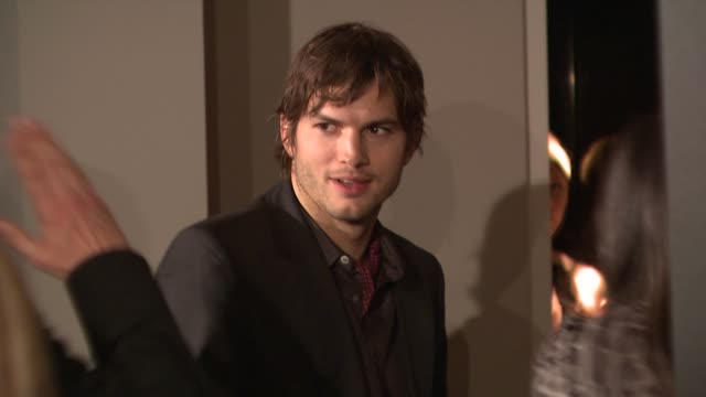 ashton kutcher demi moore at the vanity fair/bally hollywood domino party benefiting the art of elysium at los angeles ca - ashton kutcher stock videos and b-roll footage