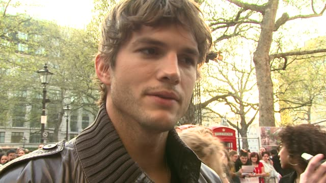 ashton kutcher on whether he's energetic in reality, whether or not becoming a family man has turned him into a slob, and being here in london at the... - the family man film title stock videos & royalty-free footage