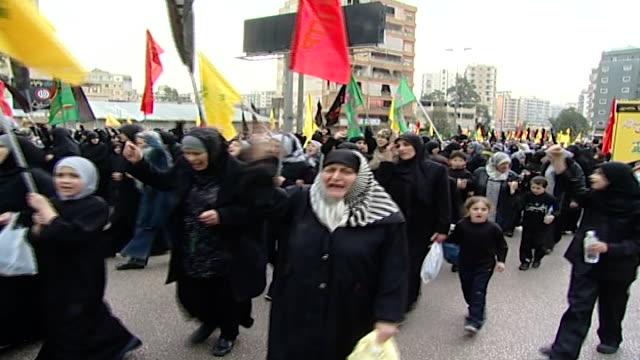 "vídeos y material grabado en eventos de stock de ashura procession organized by hezbollah in dahieh. women and girls taking part are chanting, ""labaika ya hussain, labaika ya hussain . - ashura"