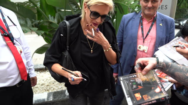 asia argento seen autographing for fans upon arrival at the hotel melia during the sitges film festival 2019 on october 3 2019 in sitges spain - autographing stock videos & royalty-free footage