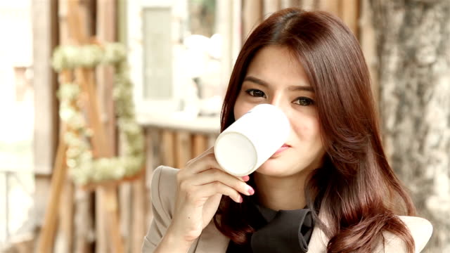 asia businesswoman drinking coffee - beautiful people stock videos & royalty-free footage