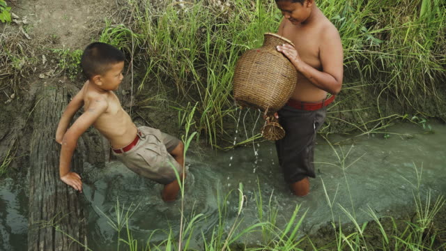 asia children playing and running - teenage boys stock videos & royalty-free footage