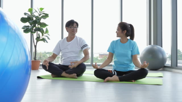 asia couple senior woman yoga - 25 29 years stock videos & royalty-free footage