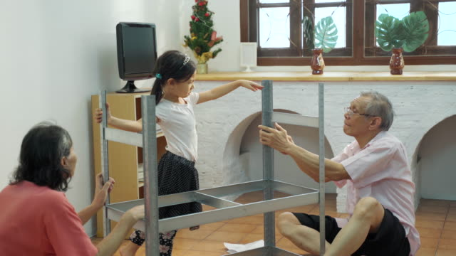 asia family senior prepare and install shelves for kid - prevenzione delle malattie video stock e b–roll