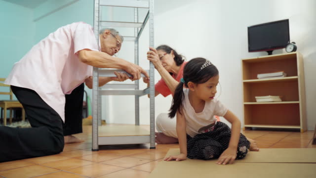 asia family senior prepare and install shelves for kid - diy stock videos & royalty-free footage