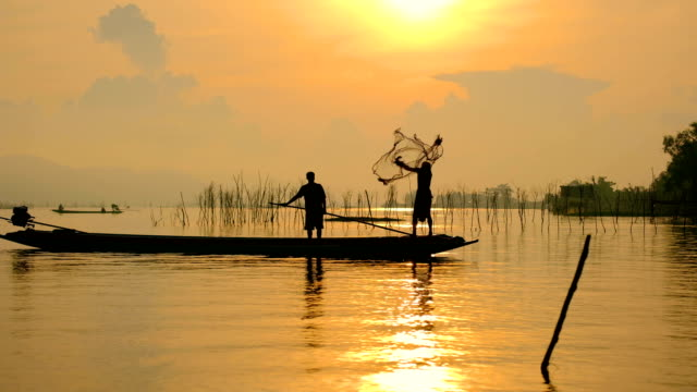 Asia Fishermen fishing at lake in Thailand