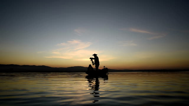 asia fishermen fishing at lake - fishing stock videos and b-roll footage