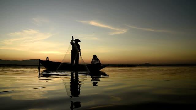 Asia Fishermen fishing at lake