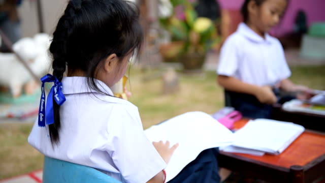 asia girls reading the book - thai ethnicity stock videos & royalty-free footage