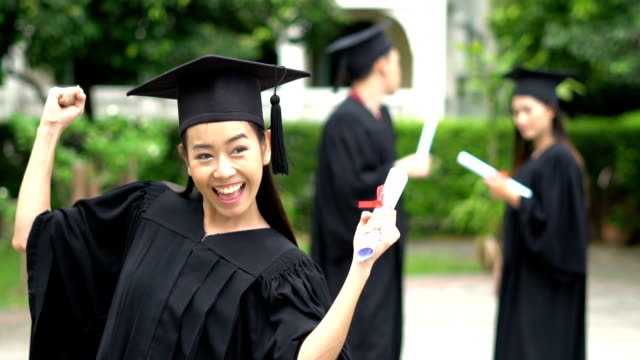 asia graduation group of successful students - mortar board stock videos and b-roll footage