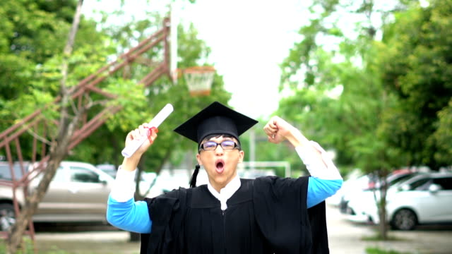 asia graduation man of successful students at university - diploma stock videos and b-roll footage