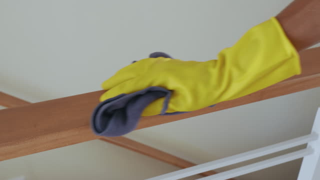 asia man wear yellow gloves for cleaning and disinfect covid-19 virus inside the house - bannister stock videos & royalty-free footage
