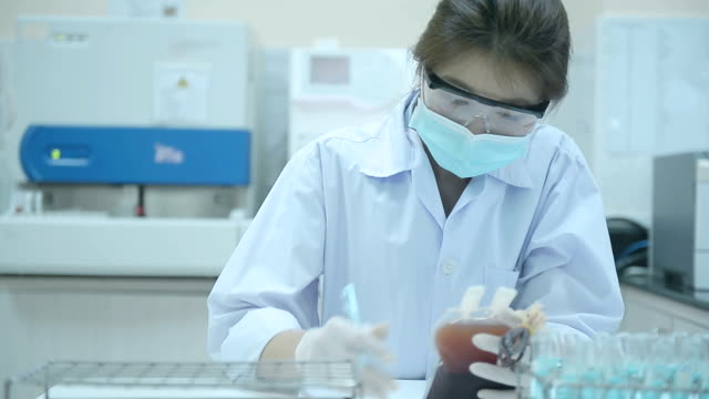 asia medical technician woman doing quality control of blood bag in laboratory hospital - blood bag stock videos & royalty-free footage