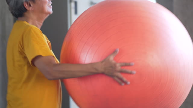 asia older man exercise ball in gym - fitness ball stock videos & royalty-free footage