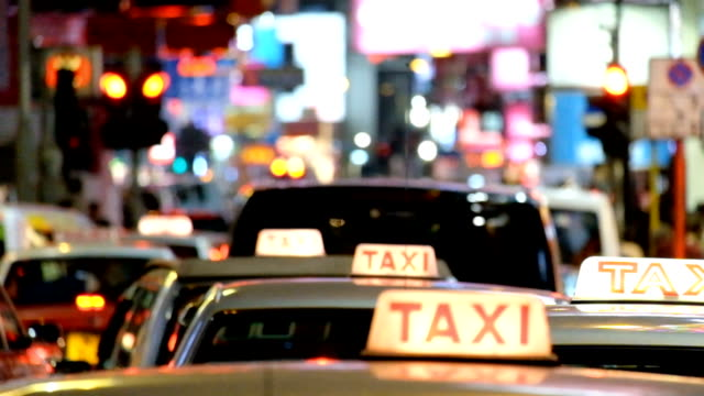 asia taxi queue service with bokeh background - taxi stand stock videos and b-roll footage